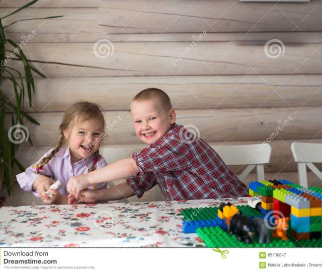 Kids Siblings Brother And Sister Playing In The Constructor Share Toys Casual Lifestyle Photo Series In Real Life Interior