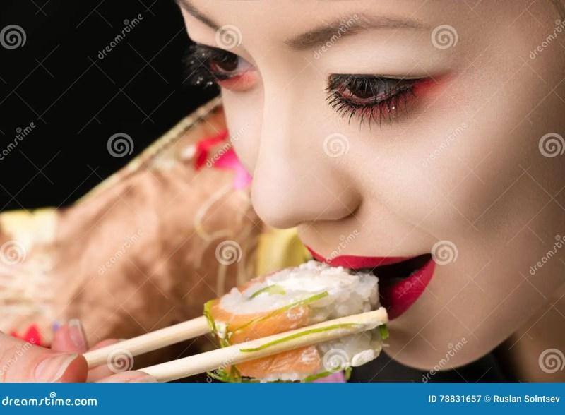 Korean Teenager Girl With Bright Makeup Eating Sushi Closeup Stock 51ab6f79e1b95