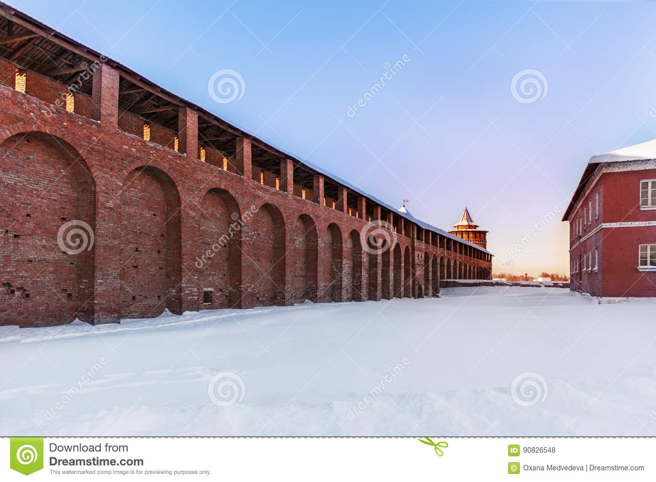 Snowy Brick Factory With Smoking Chimney At Sunset Stock