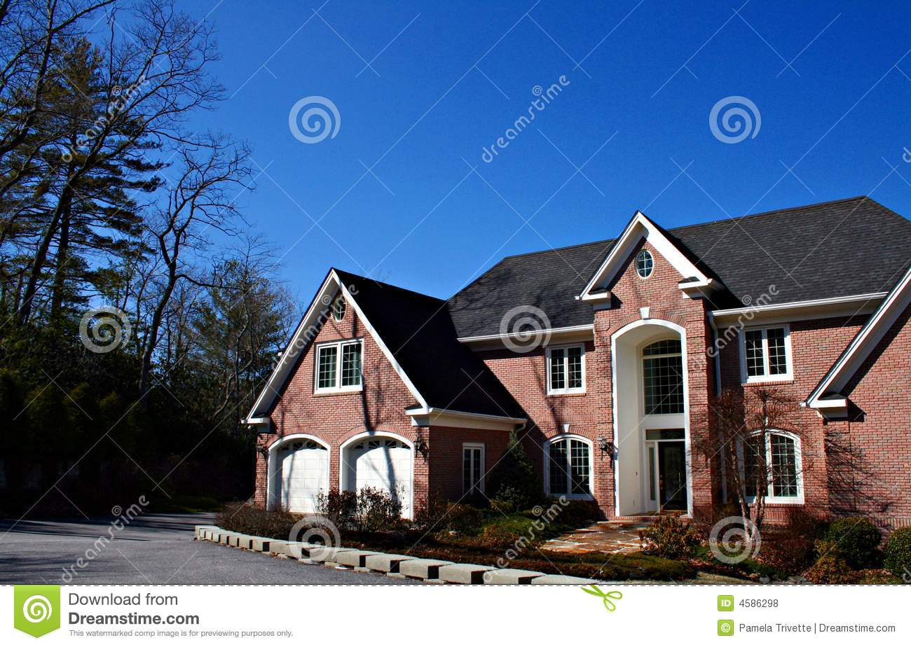 Large Brick Home With Double Garage Royalty Free Stock