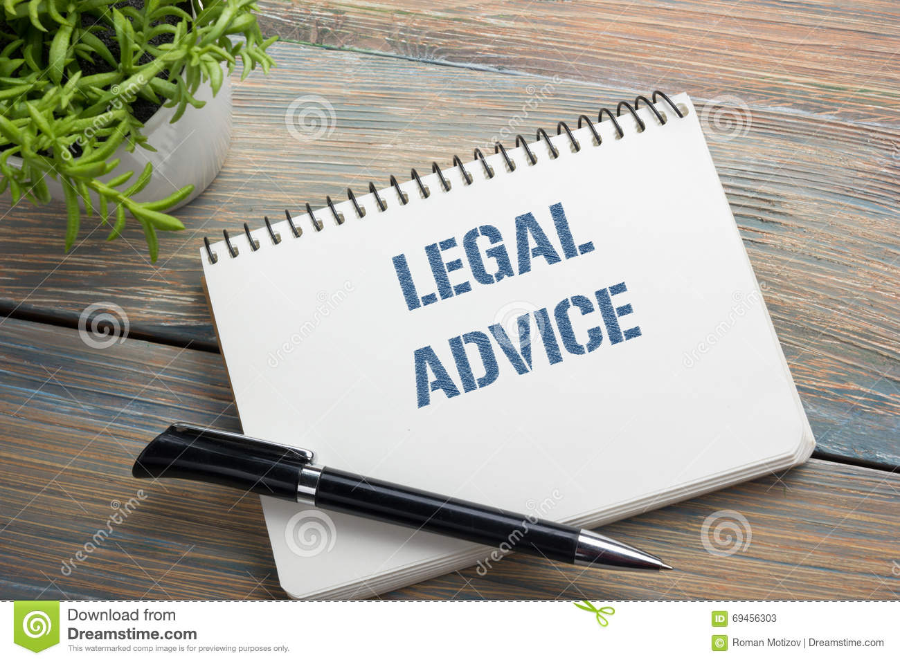Legal Advice Notepad With Message Pen And Flower Office Supplies On Desk Table Top View Stock