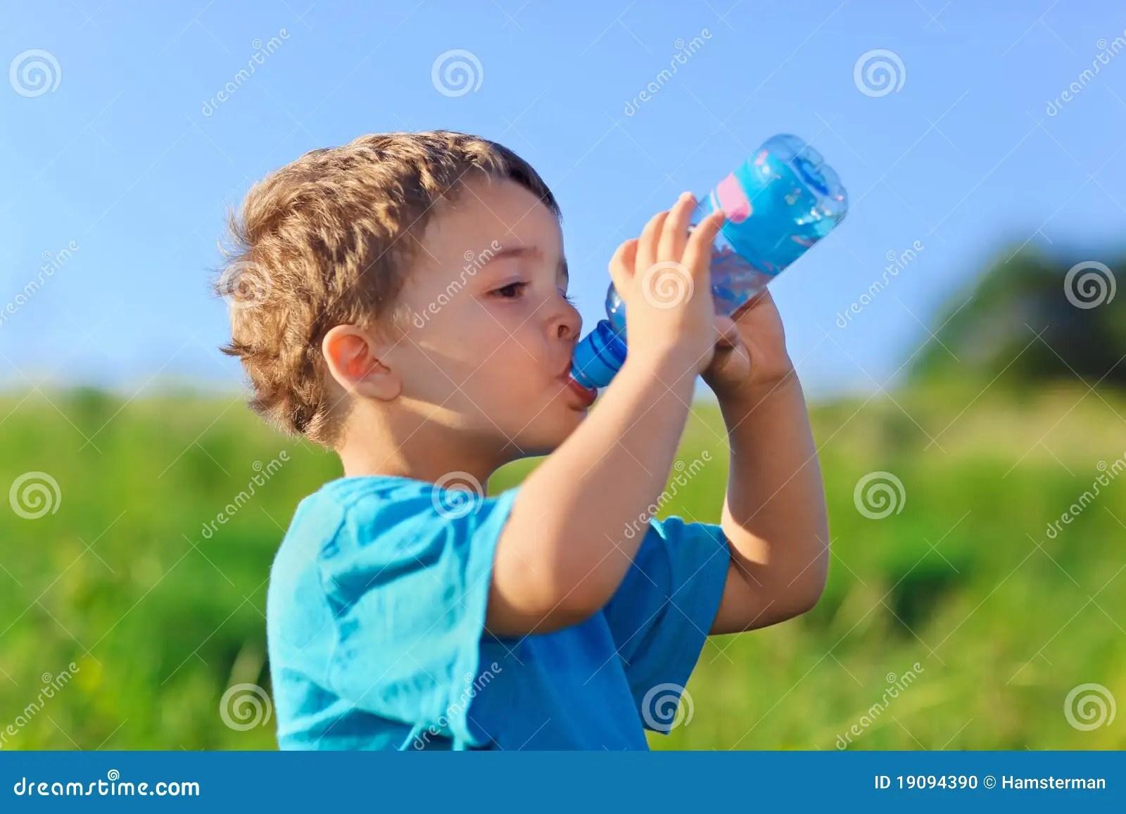 Little Boy Drinking Gas Water Stock Photo