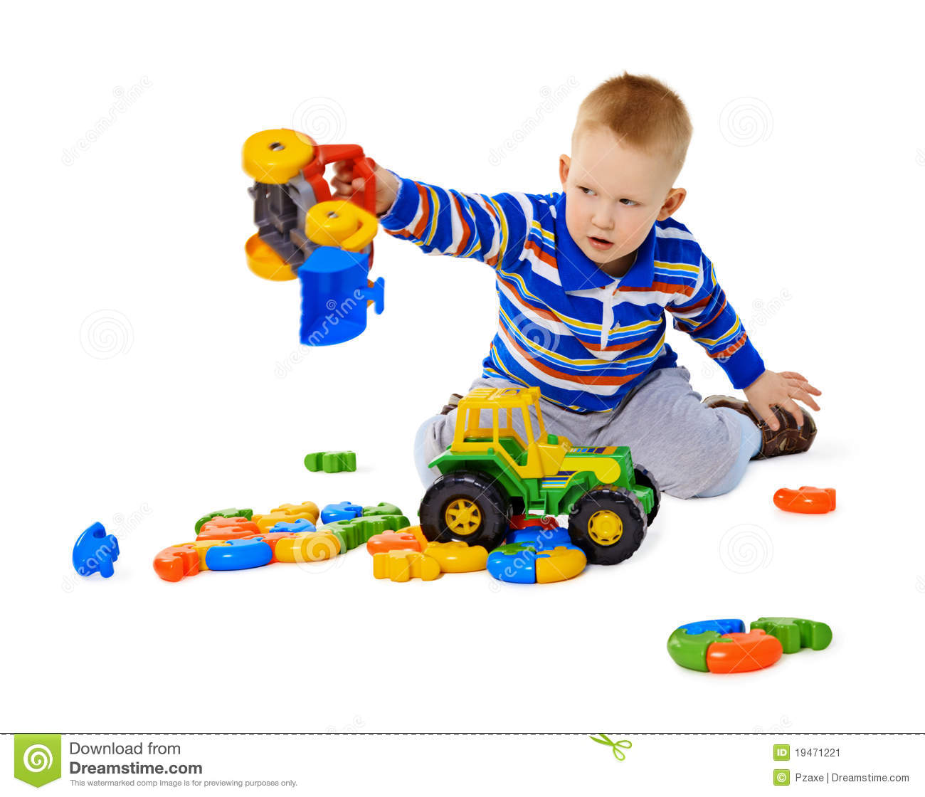 Little Boy Playing Actively With Plastic Toys Stock Image