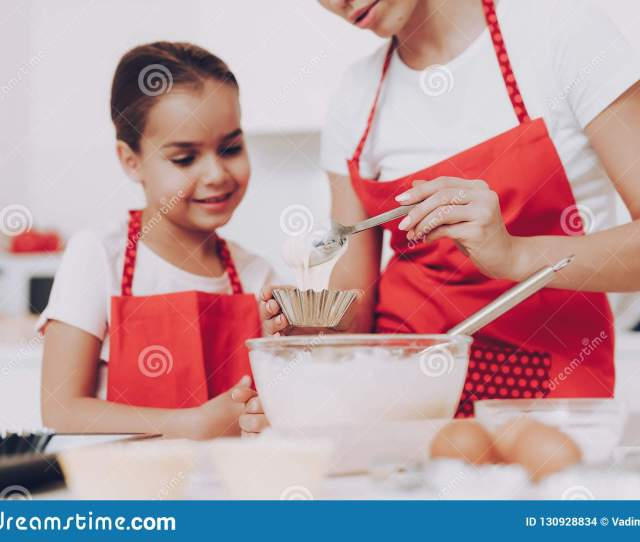 Little Girl Cook Food With Mother In Kitchen