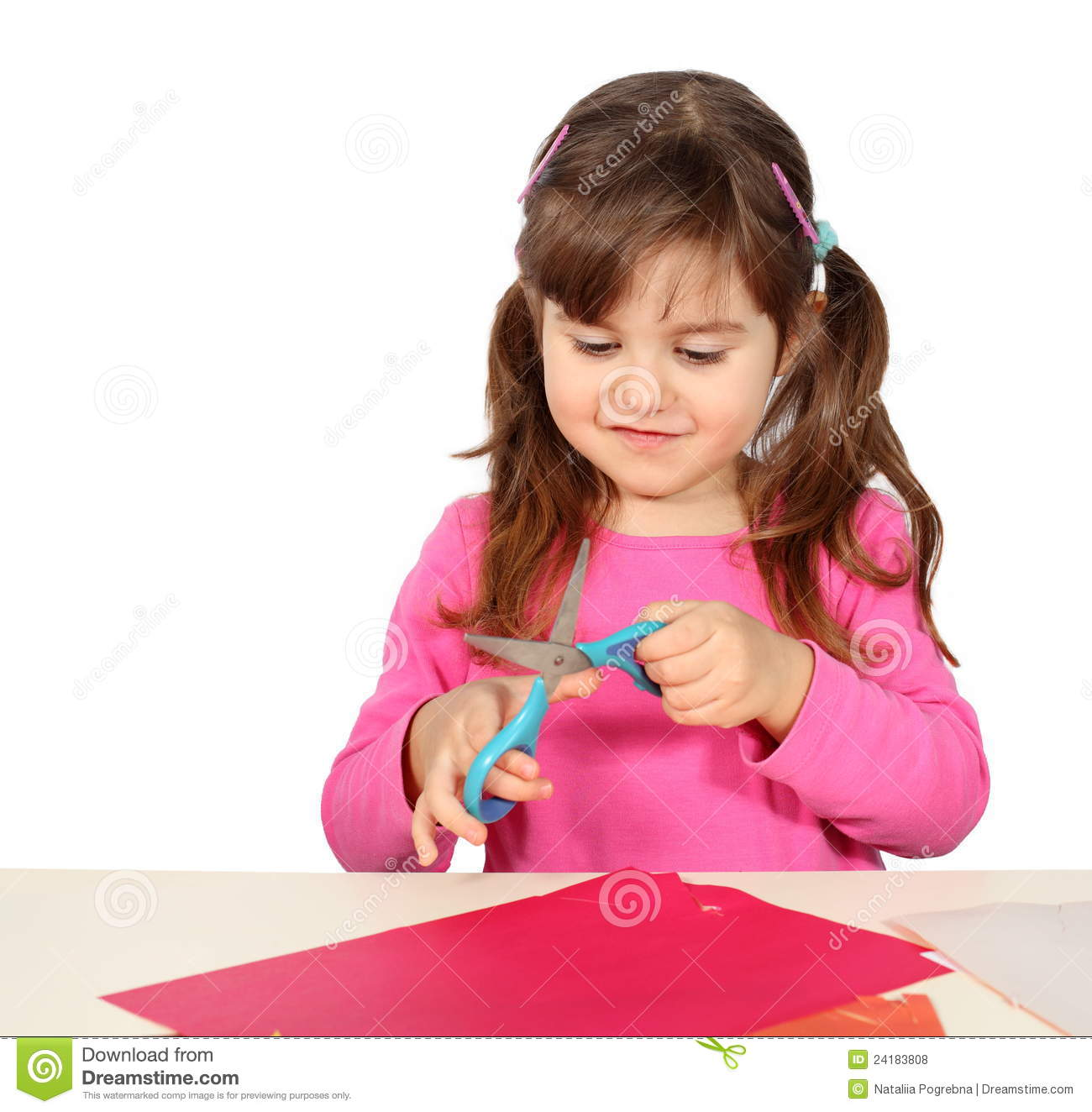 Little Girl Cutting With Scissors Stock Photo