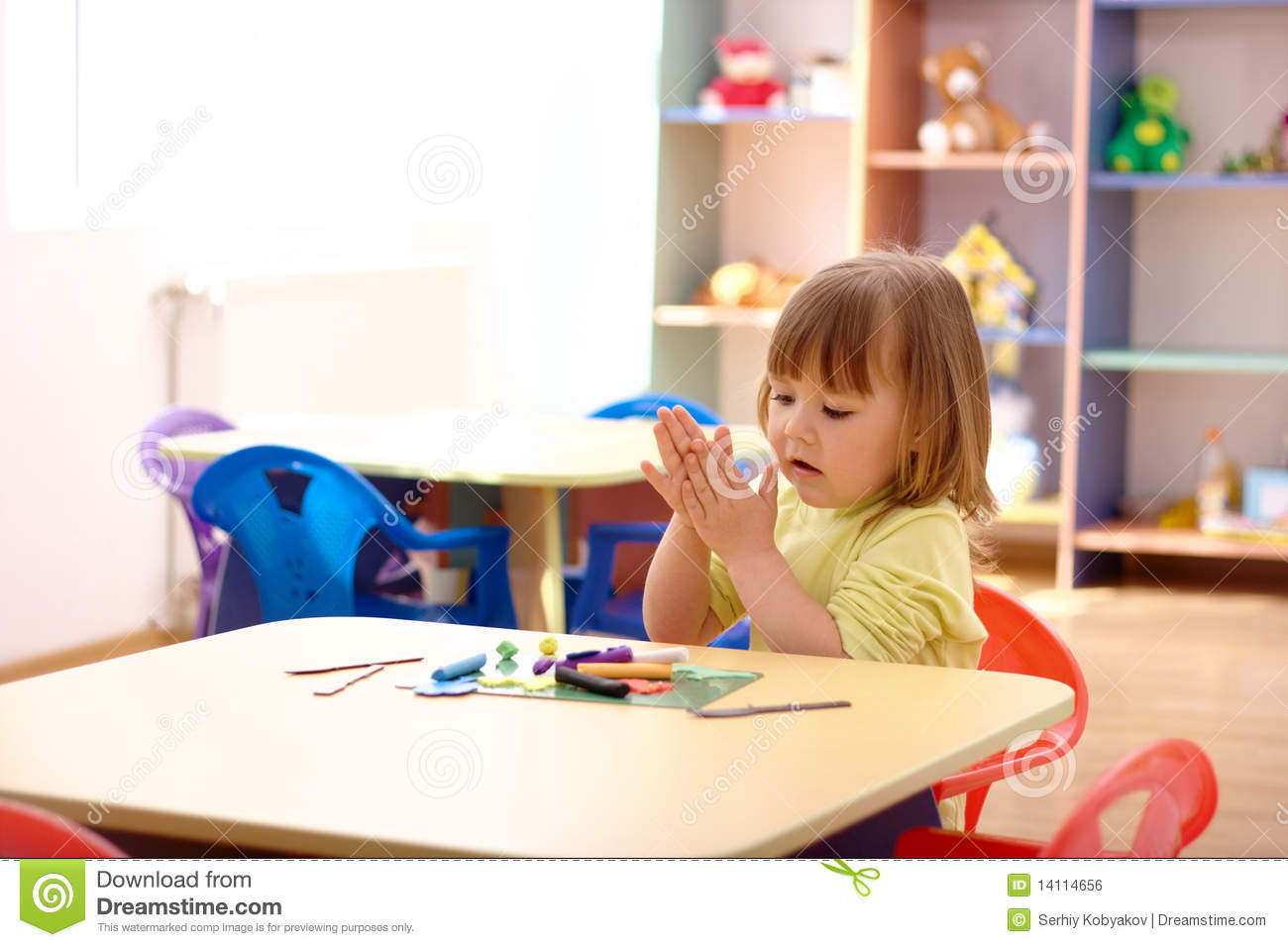 Little Girl Play With Plasticine In Preschool Stock Photo