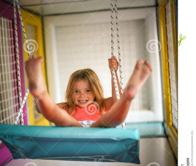 Girl Is Rocking On The Swing