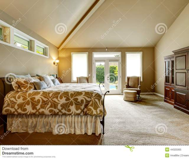 Luxury Bedroom Interior In Soft Beige Color With Beautiful Bed Wardrobe Room With High Vaulted Ceiling And Walkout Deck
