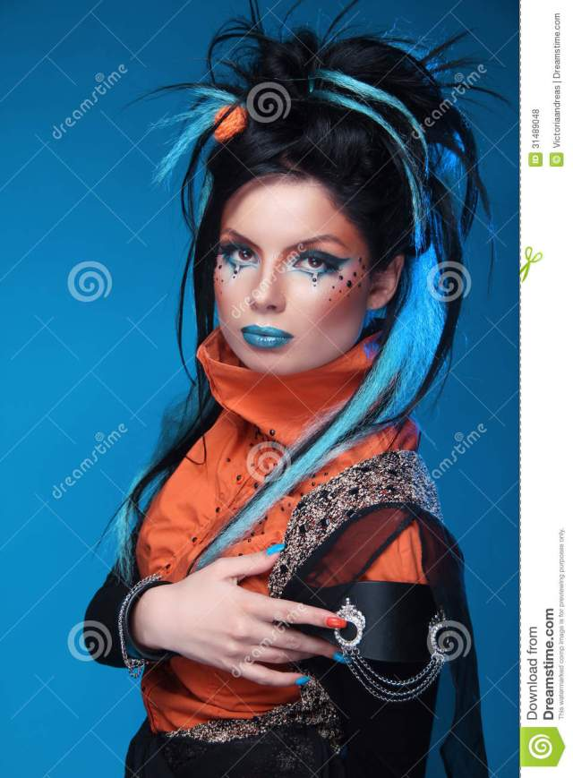 makeup. punk hairstyle. close up portrait of rock girl with
