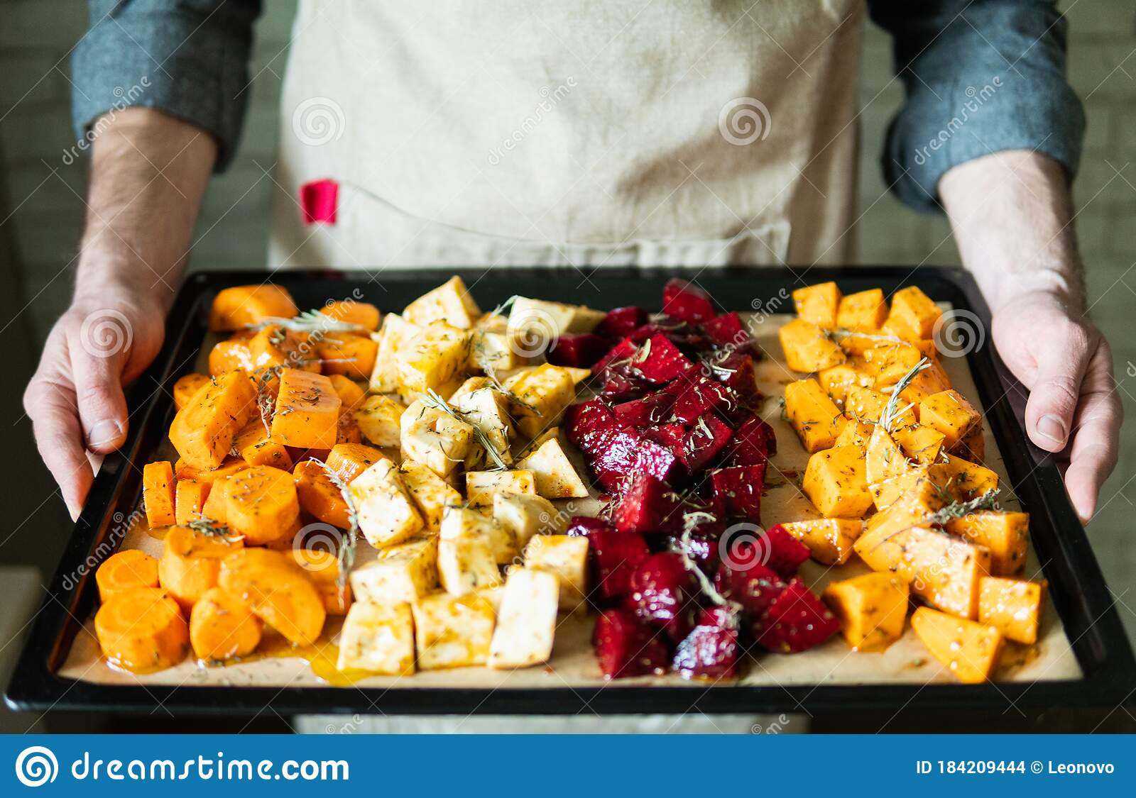 Gf is a vegetarian and i am not. Male Hands Holding Oven Tray With Vegetables Mix Vegetarian Man Cooking Sweet Potatoes And Other Veggies At Home Stock Photo Image Of Oven Male 184209444