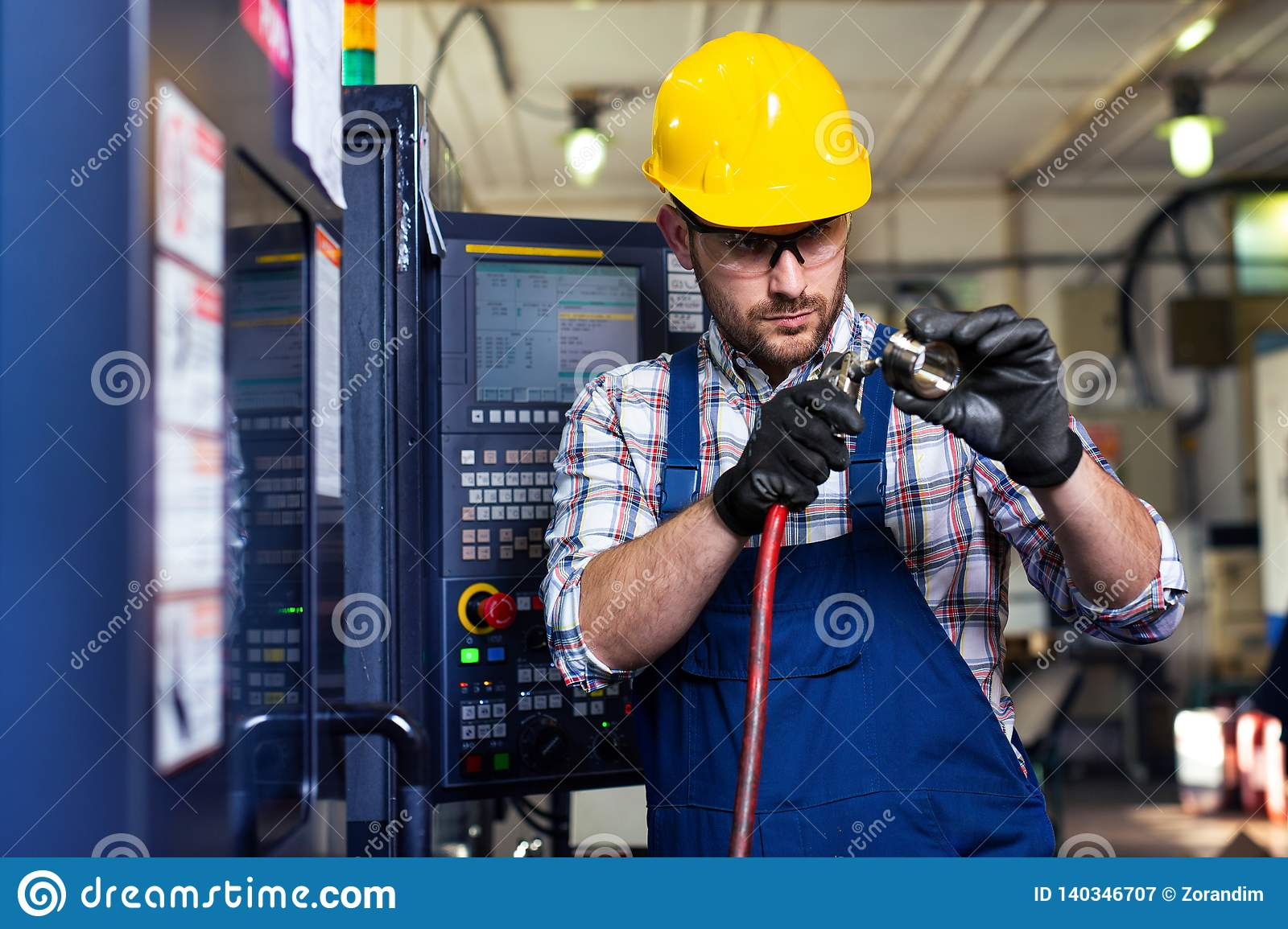 Male Worker And Quality Control Inspection In Factory