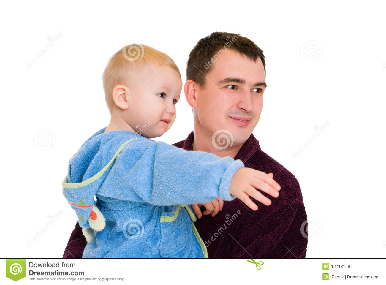 Man And Baby Dressing Gown Royalty Free Stock Images