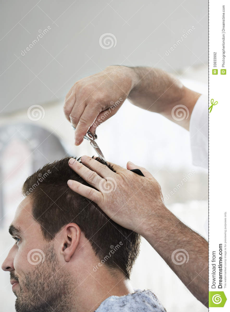 Man Getting An Haircut From Hairdresser Stock Photo