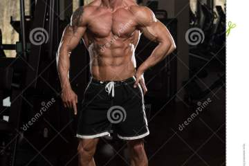 Man In Gym Showing His Well Trained Body Stock Image