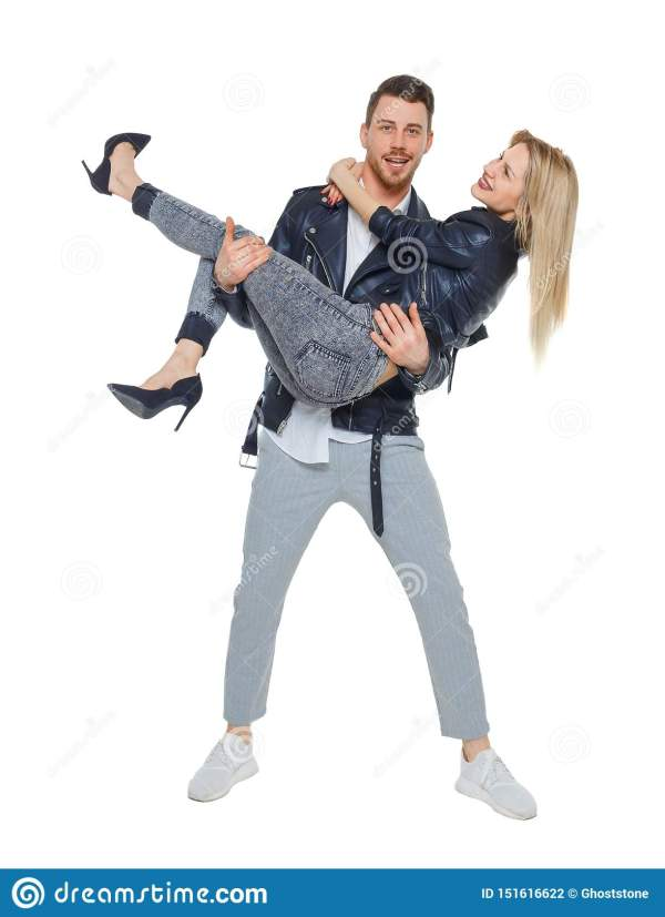 A Man Is Holding A Woman In His Arms Stock Photo - Image ...
