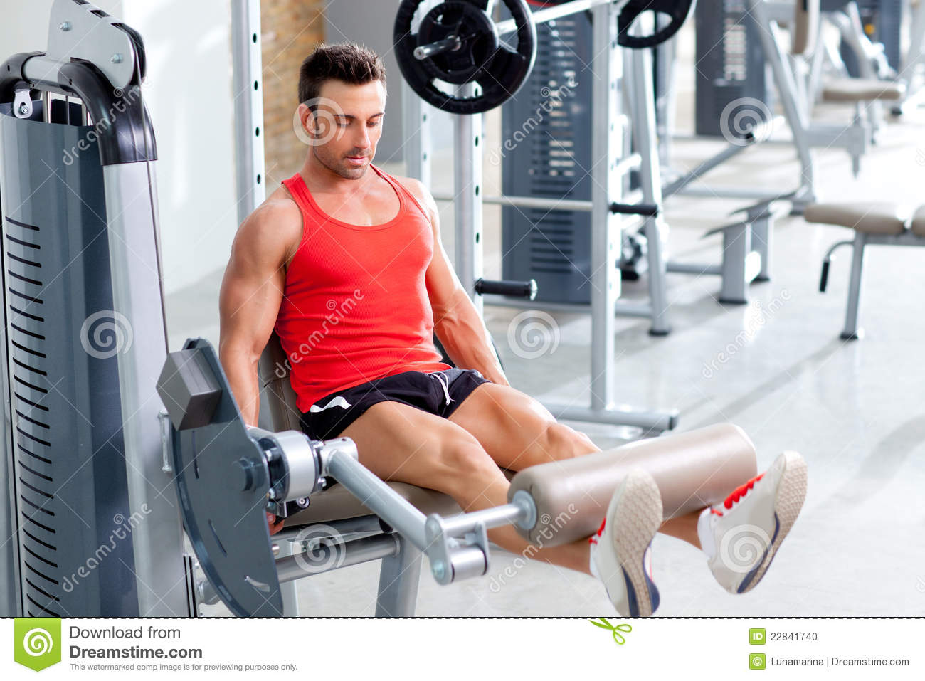 Man Lifting Weights With A Leg Press On Sport Gym Stock