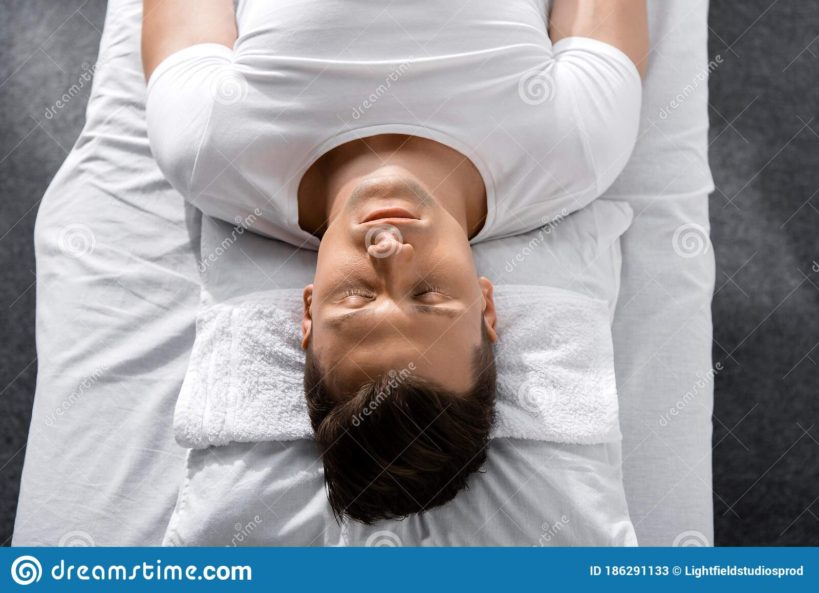 man lying on pillow on massage table with closed eyes stock image image of sleeping sunlight 186291133