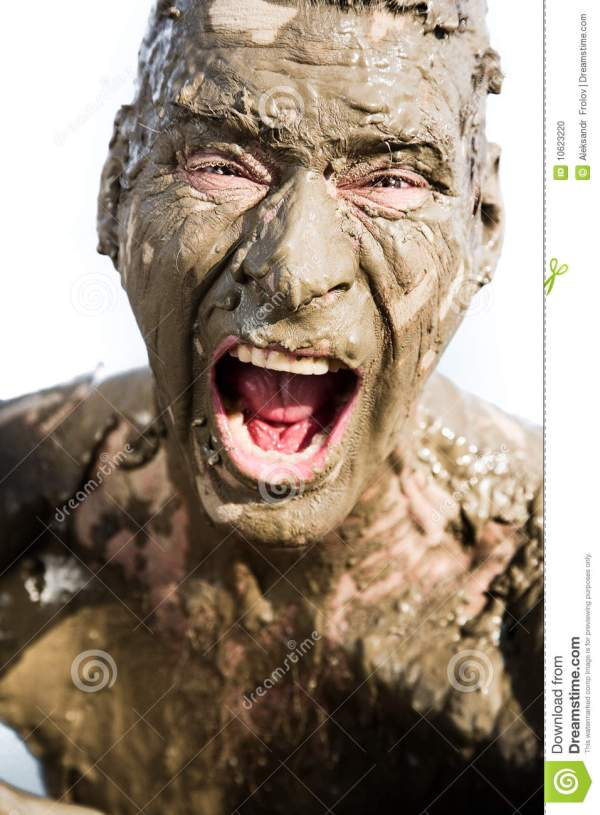 Man's Face Is Very Dirty In The Mud Stock Photo - Image ...