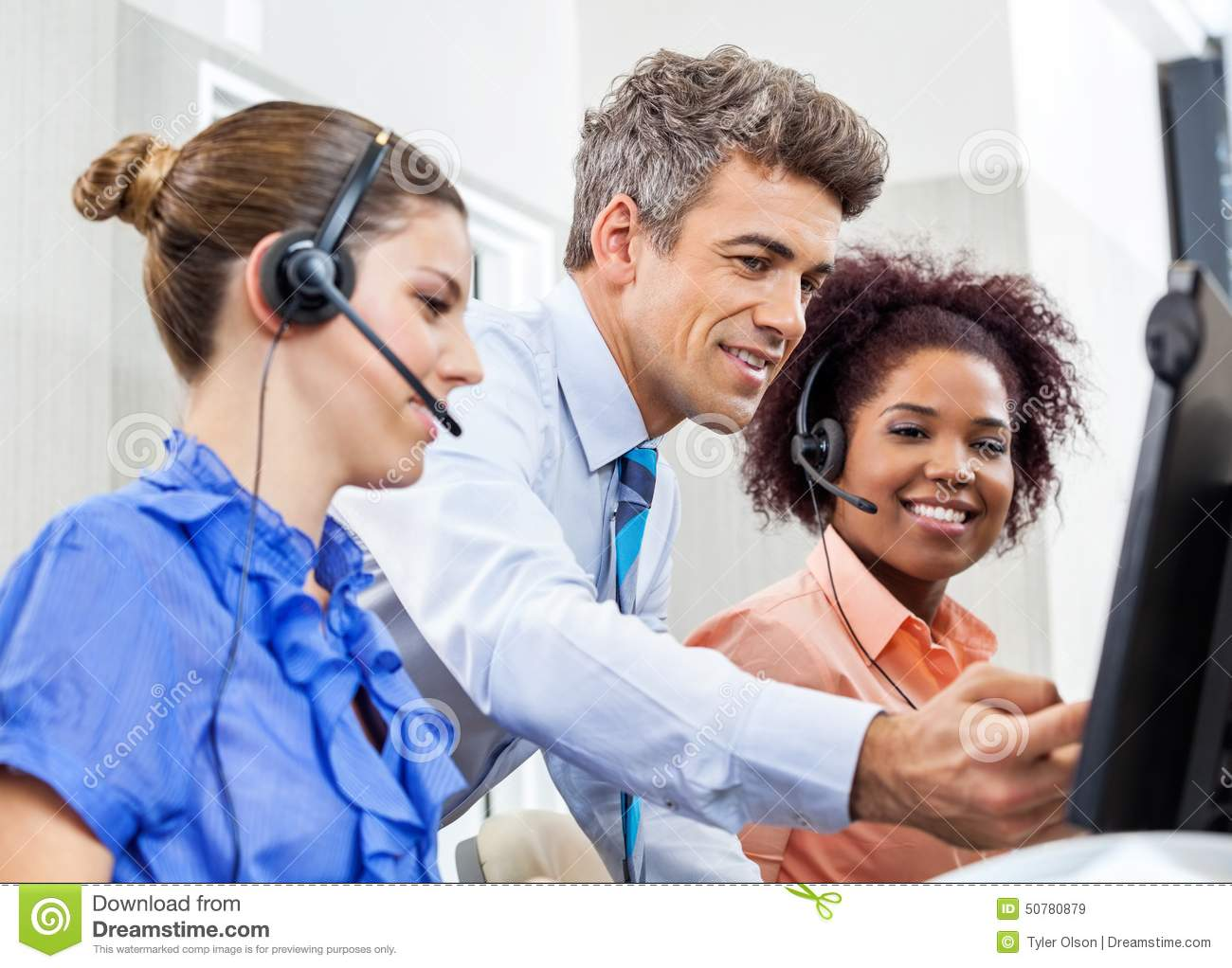 Manager Explaining To Employees In Call Center Stock Image