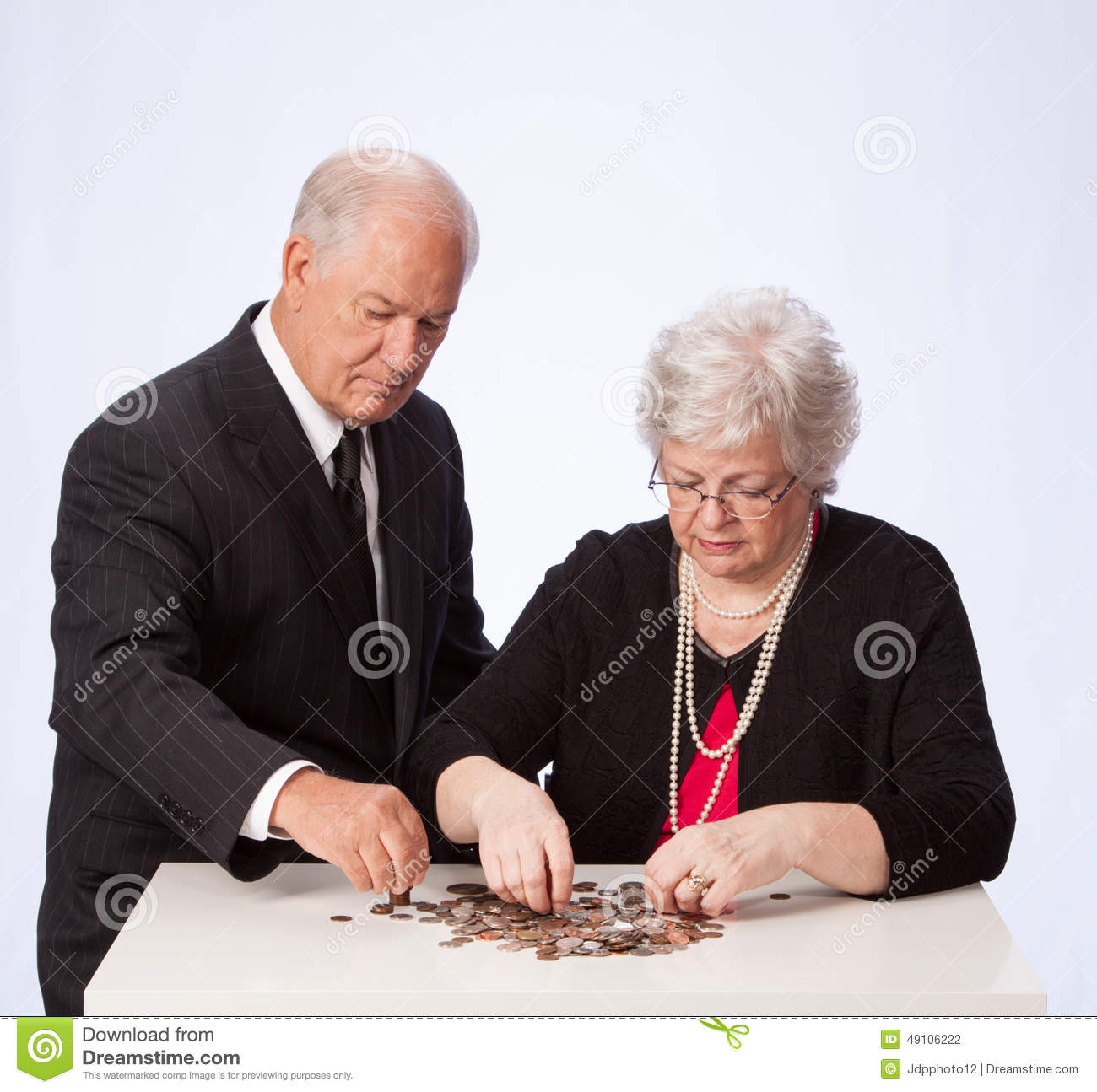 Married Couple Counting Their Money For Retirement Stock