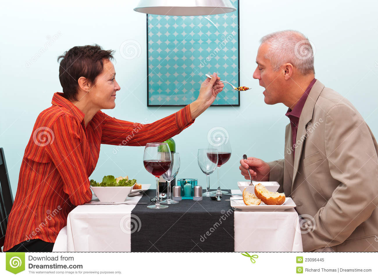 Married Couple Sharing Food In A Restaurant Stock Image