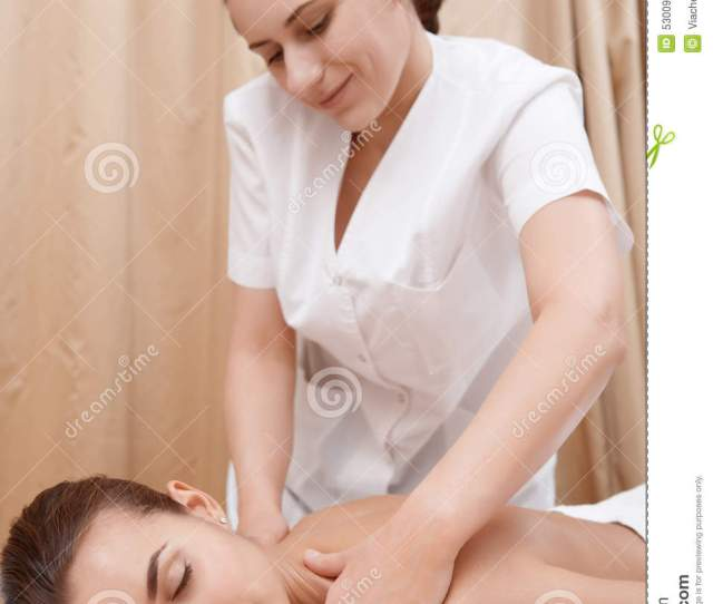Masseur Gives Massage To A Woman