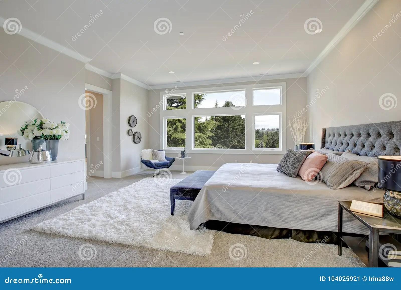 https www dreamstime com master bedroom interior king size bed light filled boasts tufted headboard dressed grey bedding facing large white image104025921
