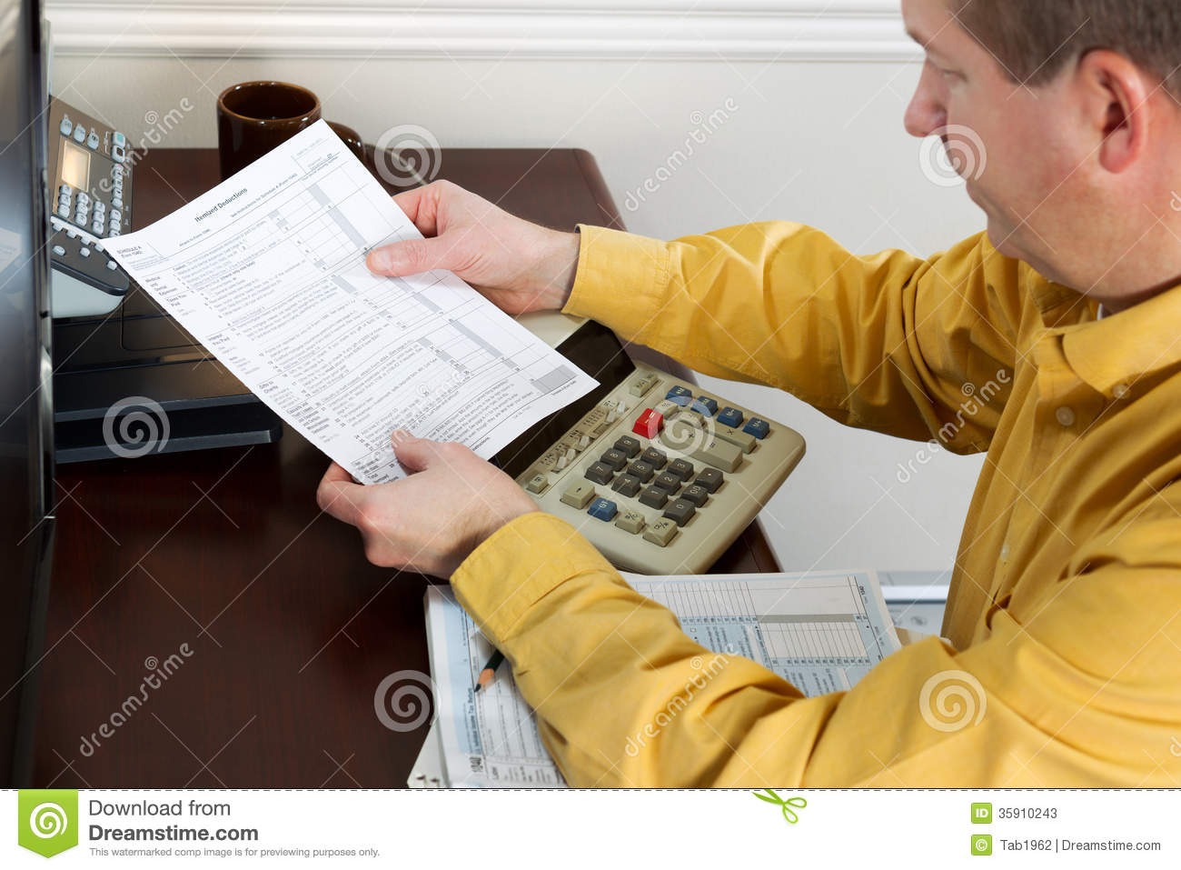 Mature Man Looking At Tax Form Print Out Stock Photos