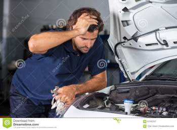 Mechanic Examining Car Engine At Repair Shop Stock Image Image 61842337