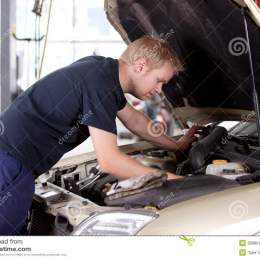 Mechanic Fixing Car Stock Photography Image 20989172