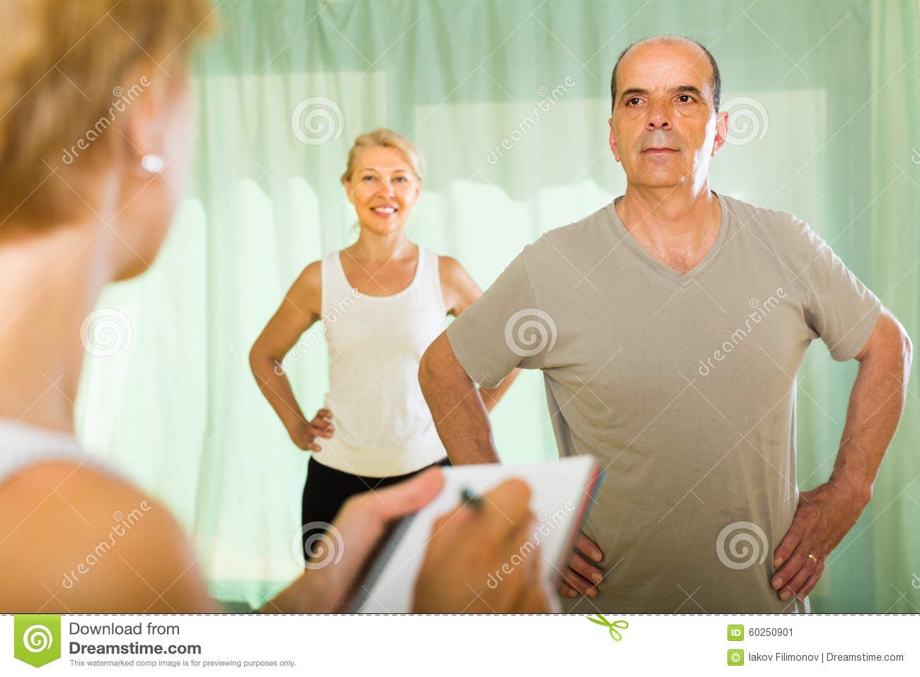 Medical Staff With Senior People At Gym Stock Image
