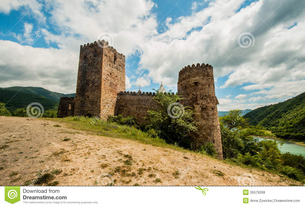 Middle Age Brick Castle In The Mountain Royalty Free