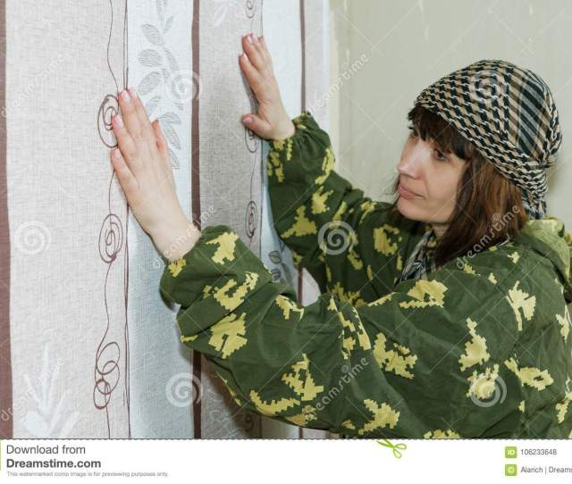 Middle Aged Woman Glues Wallpaper