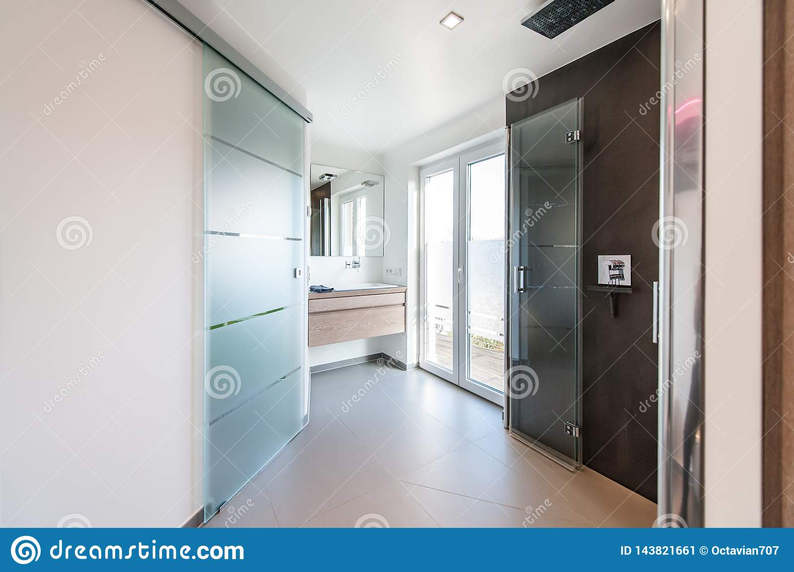 Modern Bathroom With Glass Doors And Shower Cabin Stock
