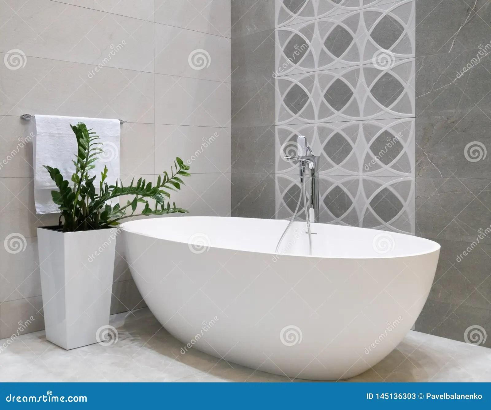 https www dreamstime com modern bathroom interior design white stone bathtub grey tiles wall ceramic flowerpot green plant hanger modern image145136303