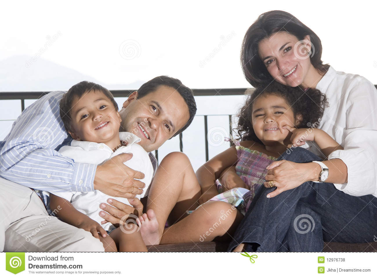 Mom And Dad Playing With Their Children Stock Photo