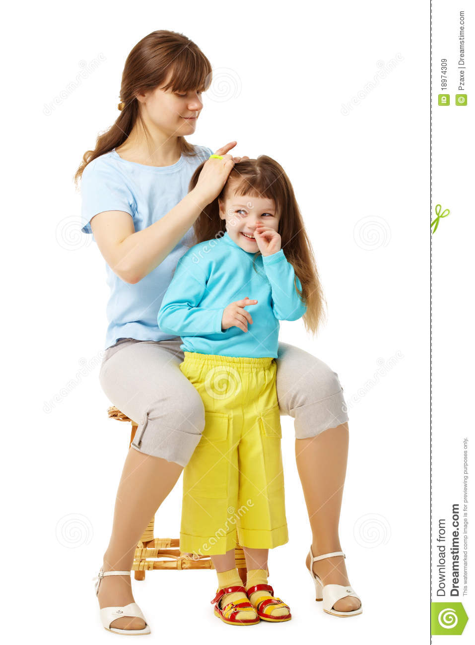 Mom Makes Daughter Hairstyle Royalty Free Stock Images