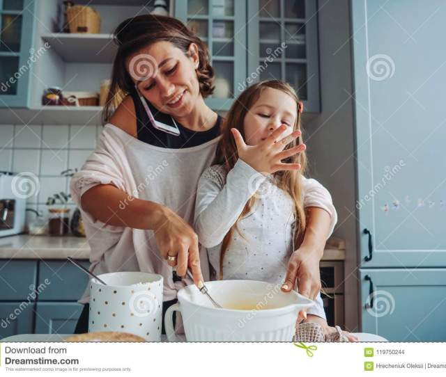 Mom Teaches Her Little Daughter How To Cook