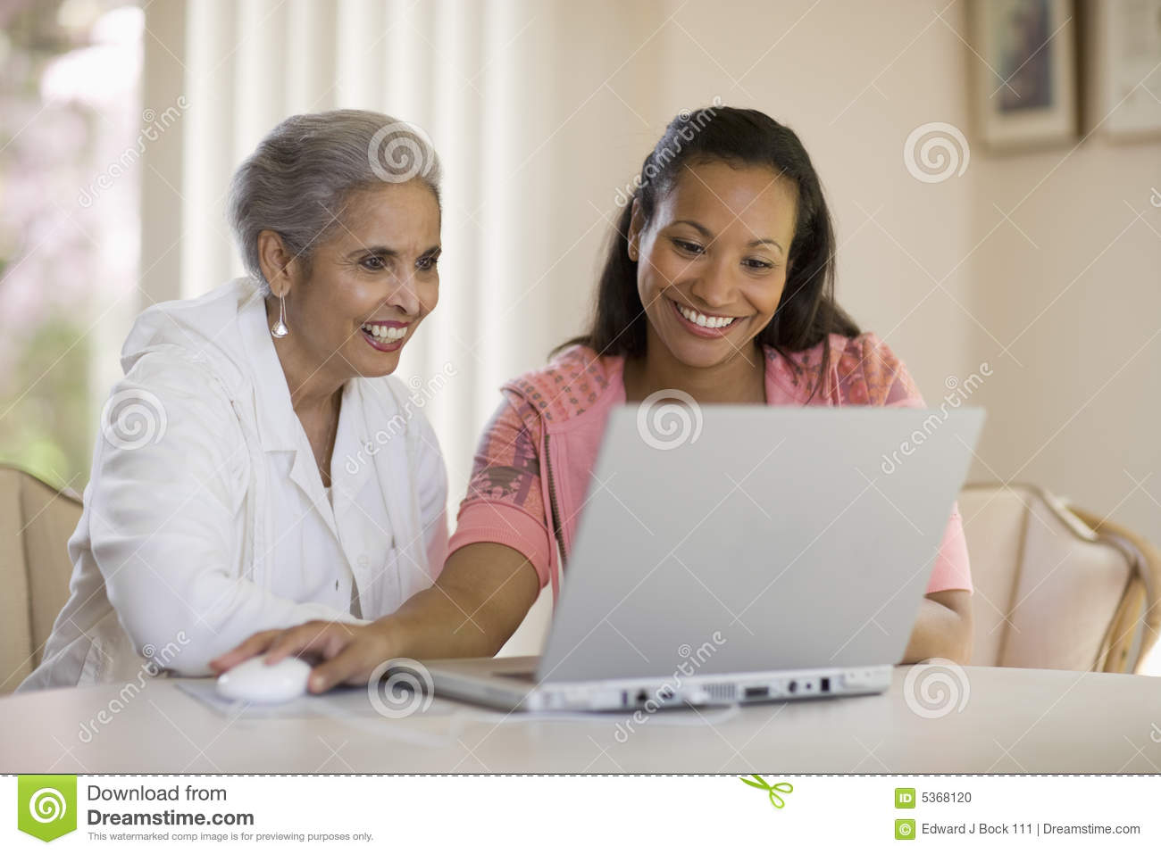 Mother And Daughter Sharing Computer Stock Photo