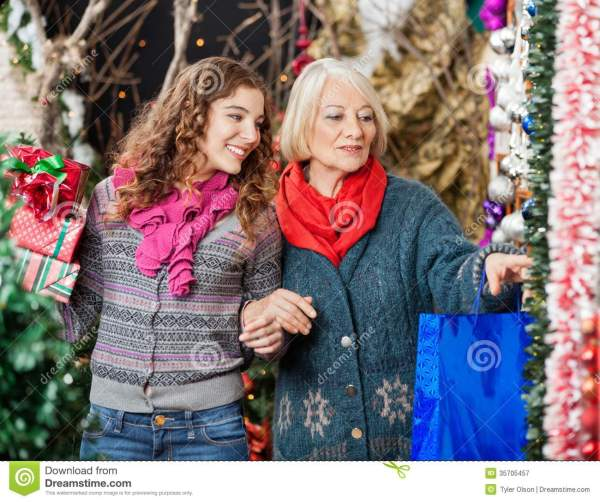 Mother And Daughter Shopping For Christmas Royalty Free ...