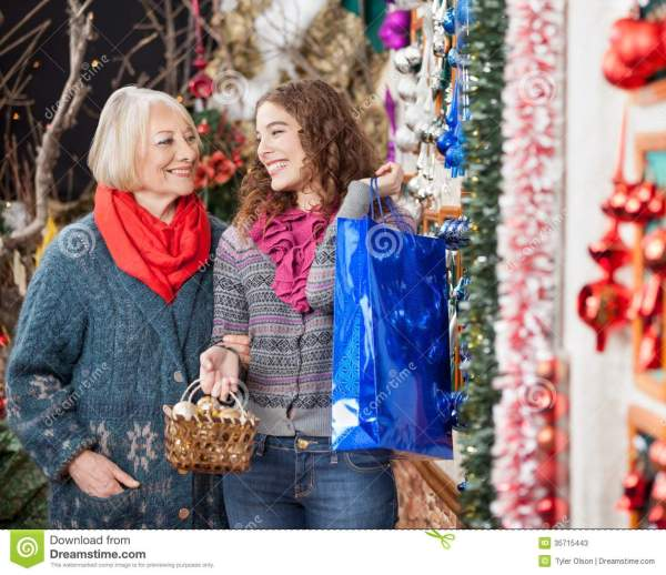 Mother And Daughter Shopping In Christmas Store Stock ...