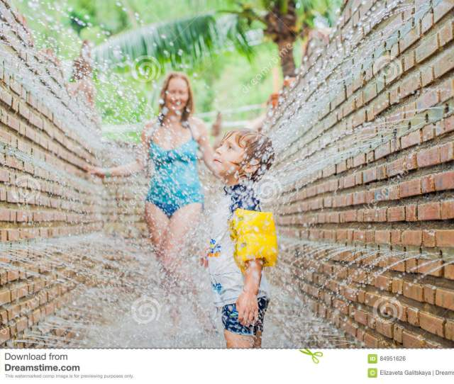 Mother And Son In The Massage Shower From The Wall
