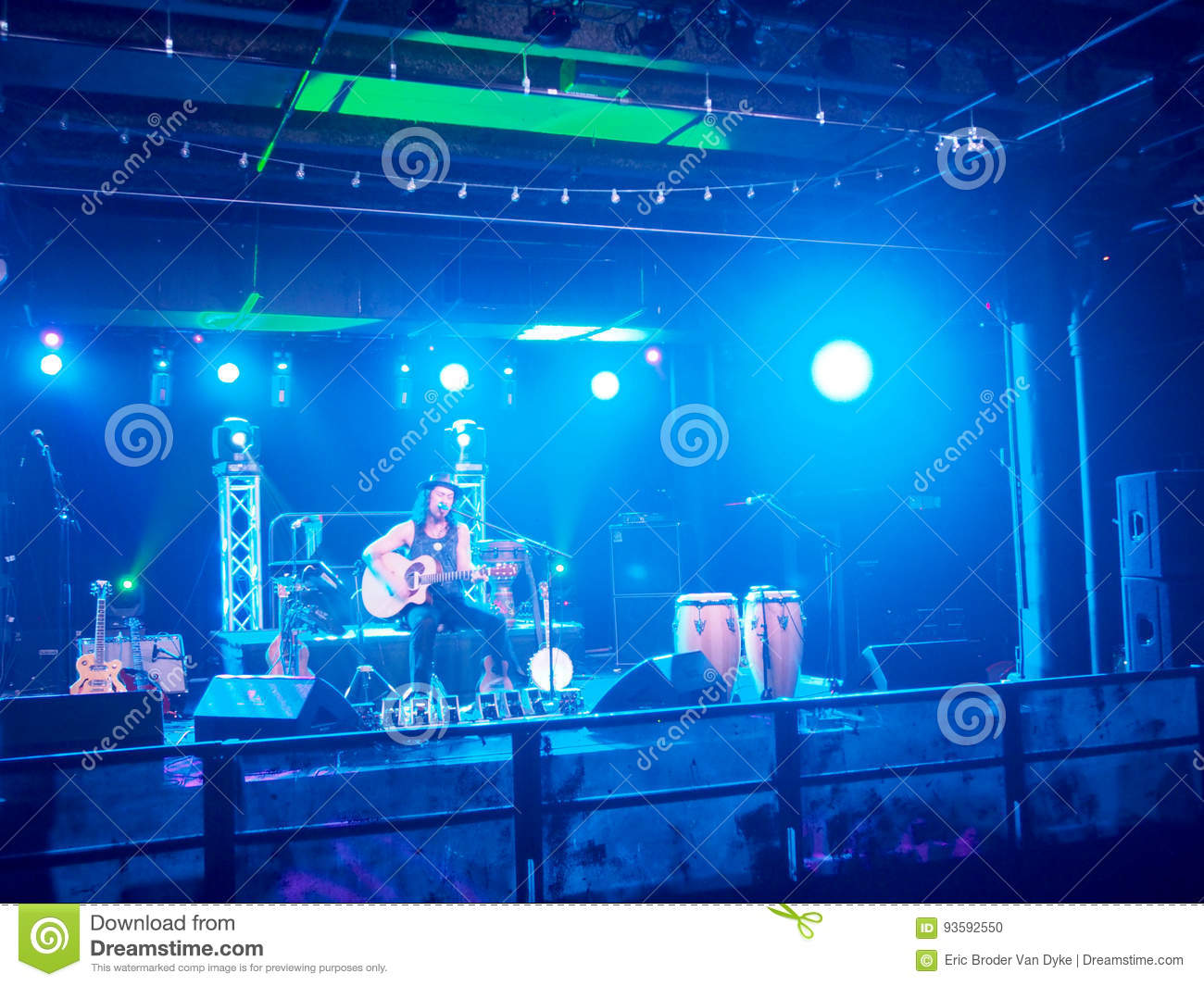 musician tavana play guitar and sing on stage in blue light editorial image image of people guidance 93592550