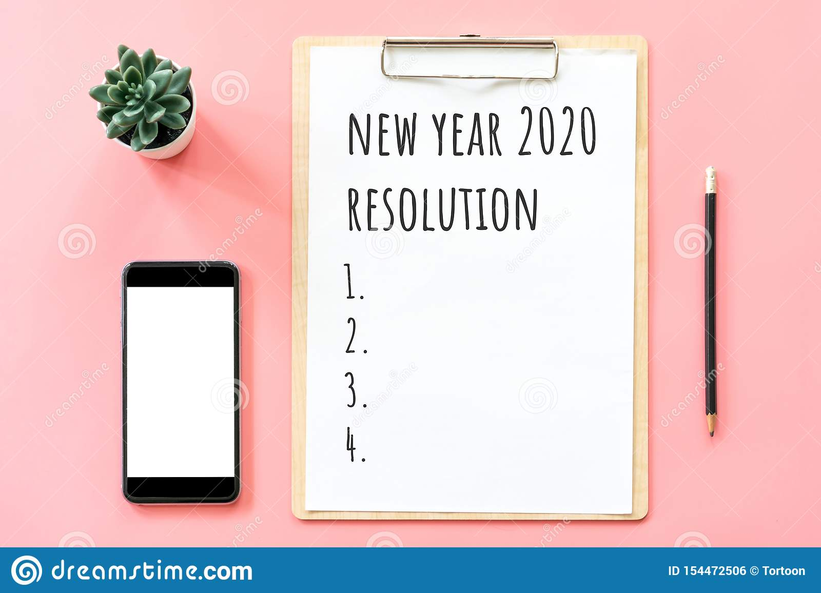 New Year Concept Resolution List In Stationery