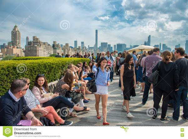 New York City - May 14, 2016: People Chilling On Rooftop ...