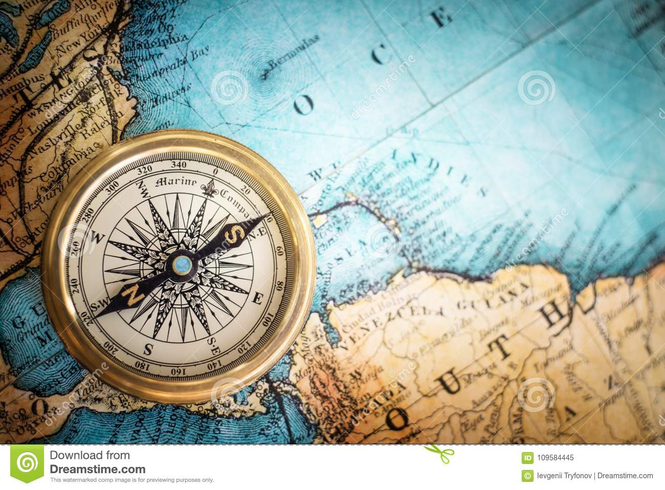 Old Vintage Retro Compass On Ancient Map Background Stock