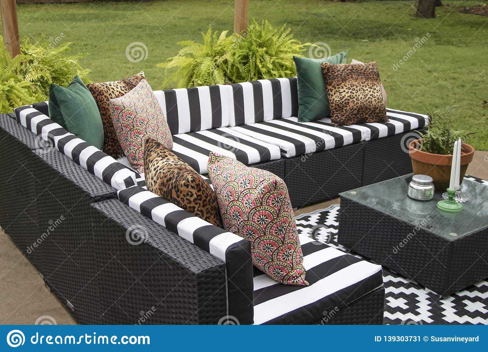 https www dreamstime com outdoor lawn furniture black white crisply striped upholstery assorted pillows grouped around table ferns image139303731