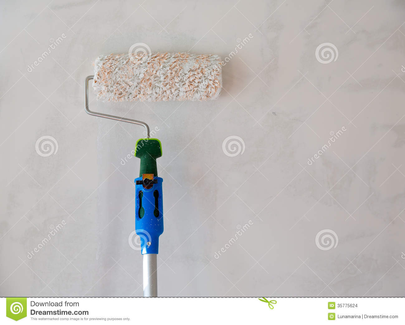 Paint Roller For Painting Wall After Plastering Stock