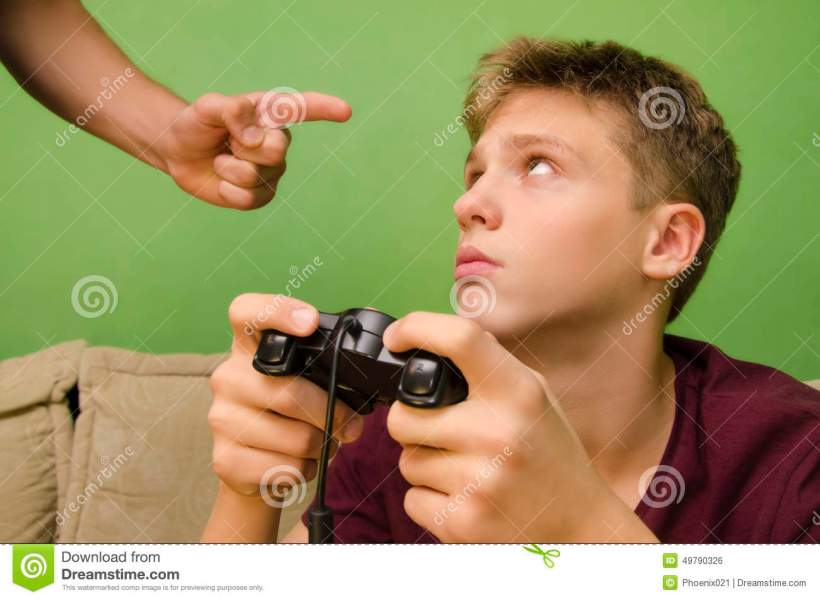 Parent Schooling His Kid Not To Play Video Games  Stock Photo     Parents hand forbidding kid to play video games  Kid with sad face looking  up  Isolated background