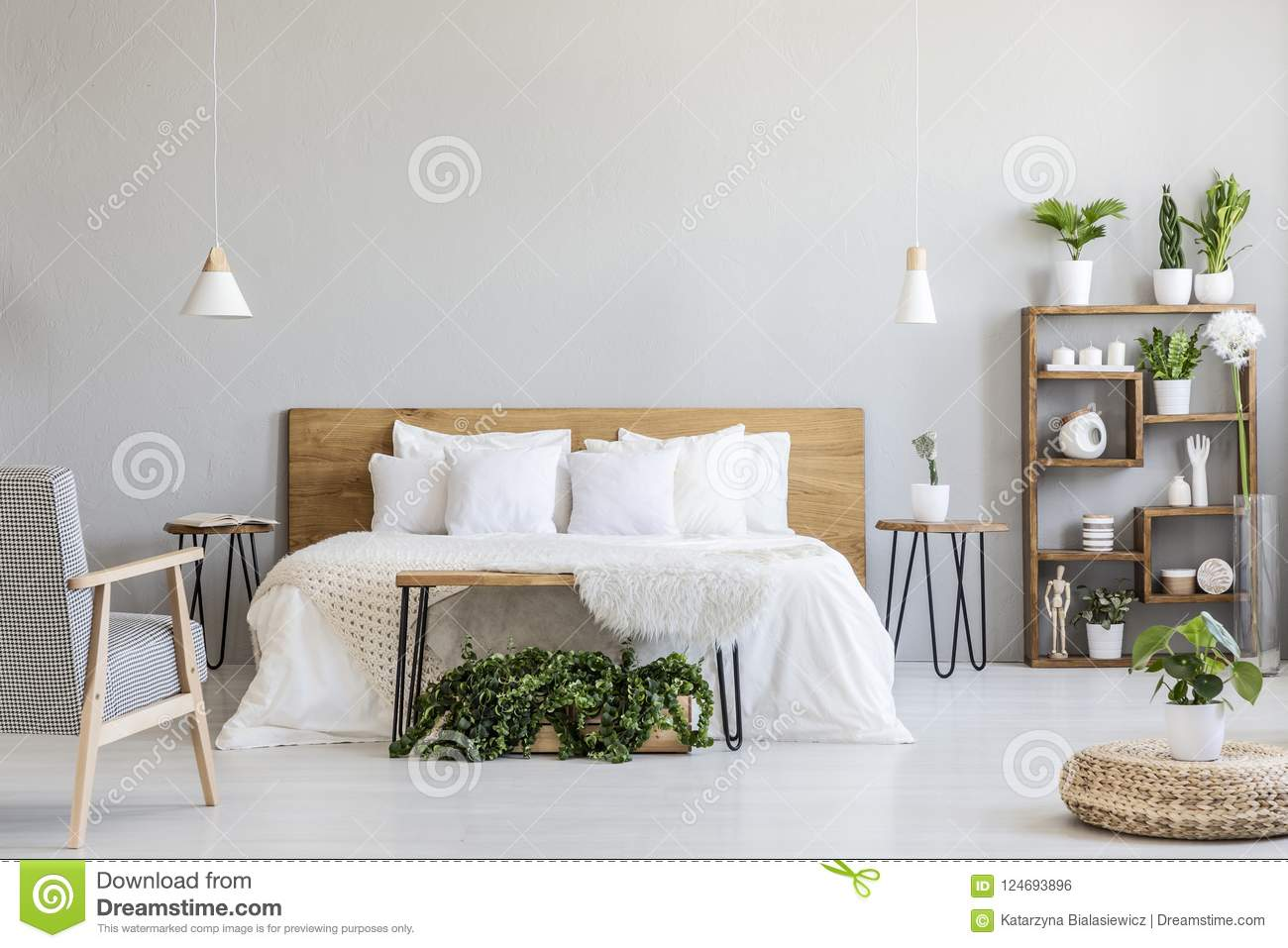 Patterned Armchair Near White Wooden Bed In Grey Bedroom